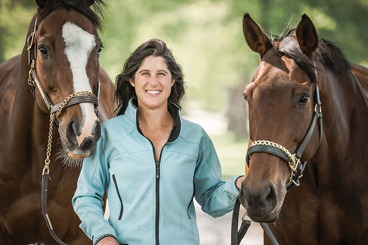 Nikki Dalesandro Scherrer '07 with two horses