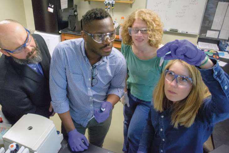 Sharon Crary with students in the lab