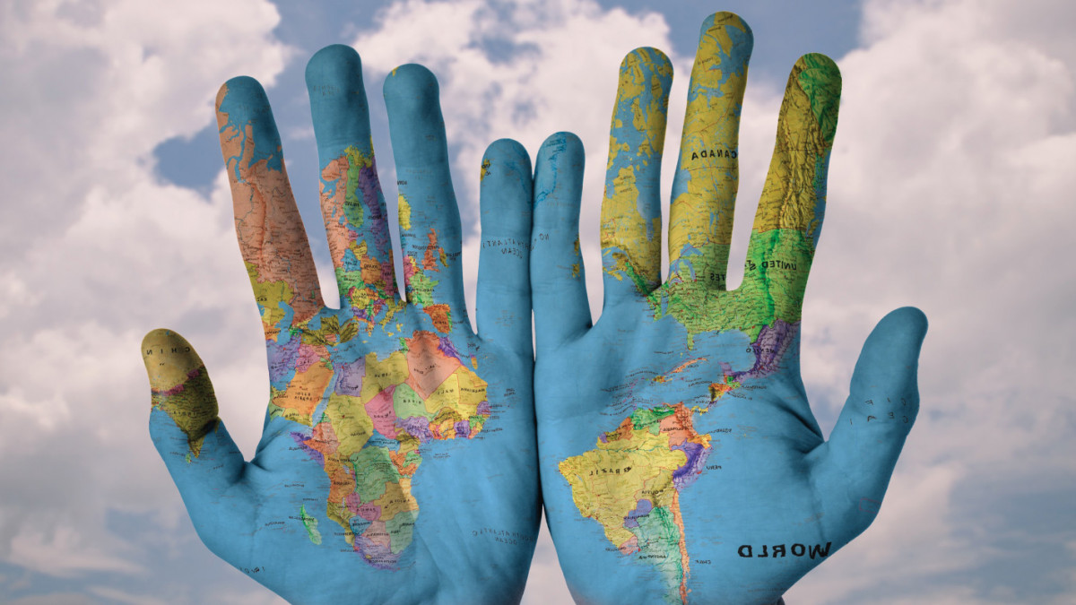 Map of the world painted onto two hands
